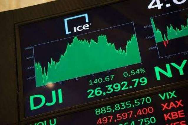 Earnings lift Wall St. to record highs; dollar fall continues